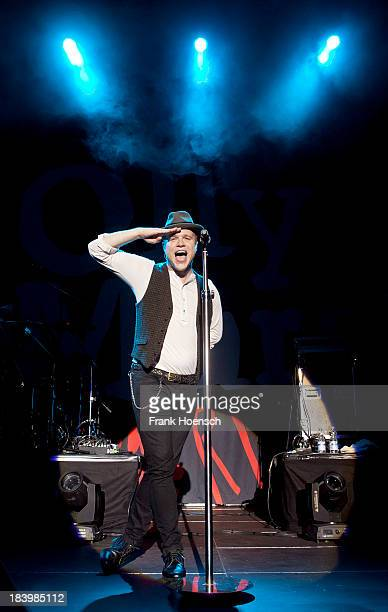 Singer Olly Murs performs live during a concert at the Tempodrom on October 10 2013 in Berlin Germany