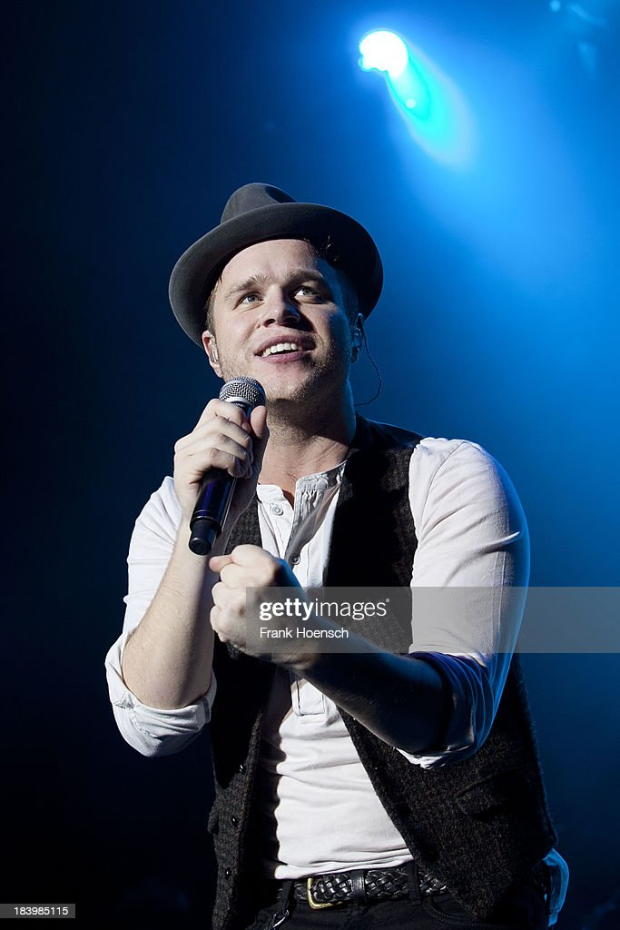 Singer <a gi-track='captionPersonalityLinkClicked' href=/galleries/search?phrase=Olly+Murs&family=editorial&specificpeople=6350751 ng-click='$event.stopPropagation()'>Olly Murs</a> performs live during a concert at the Tempodrom on October 10, 2013 in Berlin, Germany.