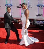 Singer Omarion and Apryl Jones arrive at the BET AWARDS 14 at Nokia Theatre LA Live on June 29 2014 in Los Angeles California