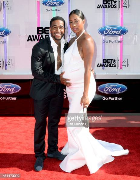 Singer Omarion and Apryl Jones attend the BET AWARDS '14 at Nokia Theatre LA LIVE on June 29 2014 in Los Angeles California