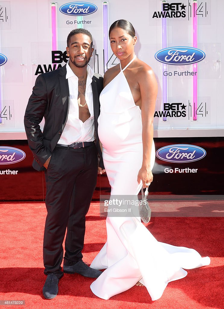 Singer Omarion (L) and Apryl Jones attend the BET AWARDS '14 at Nokia Theatre L.A. LIVE on June 29, 2014 in Los Angeles, California.