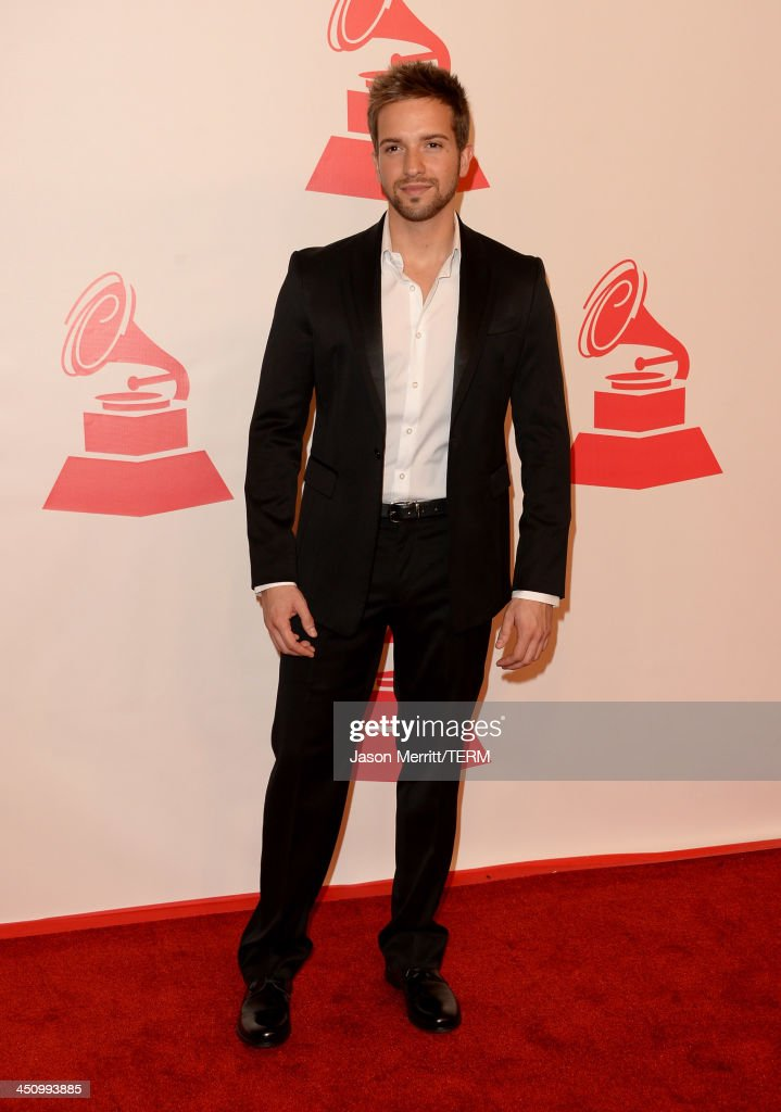 Singer <a gi-track='captionPersonalityLinkClicked' href=/galleries/search?phrase=Pablo+Alboran&family=editorial&specificpeople=7512466 ng-click='$event.stopPropagation()'>Pablo Alboran</a> arrives at the 2013 Latin Recording Academy Person Of The Year honoring Miguel Bose at the Mandalay Bay Convention Center on November 20, 2013 in Las Vegas, Nevada.