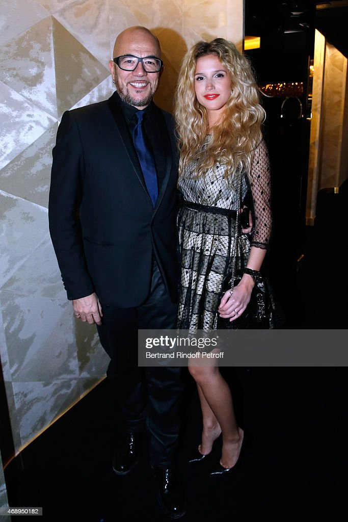 Singer <a gi-track='captionPersonalityLinkClicked' href=/galleries/search?phrase=Pascal+Obispo&family=editorial&specificpeople=549855 ng-click='$event.stopPropagation()'>Pascal Obispo</a> (L) and his companion Julie Hantson attend the 'Paris Merveilles', Lido New Revue : Opening Gala on April 8, 2015 in Paris, France.