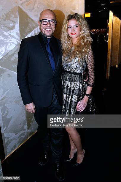 Singer Pascal Obispo and his companion Julie Hantson attend the 'Paris Merveilles' Lido New Revue Opening Gala on April 8 2015 in Paris France