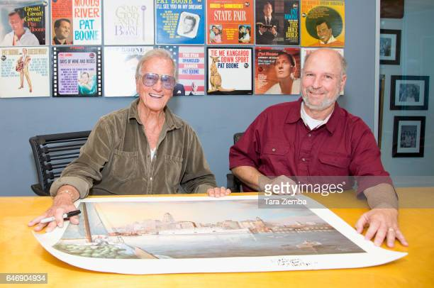 Singer Pat Boone and President of the Jewish American Society for Historic Preservation Jerry Klinger sign a 70th Anniversary Commemorative print...