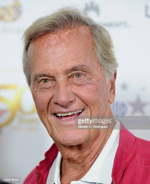 Singer Pat Boone arrives to the Hollywood Walk of Fame's 50th Anniversary Celebration on November 3 2010 in Hollywood California