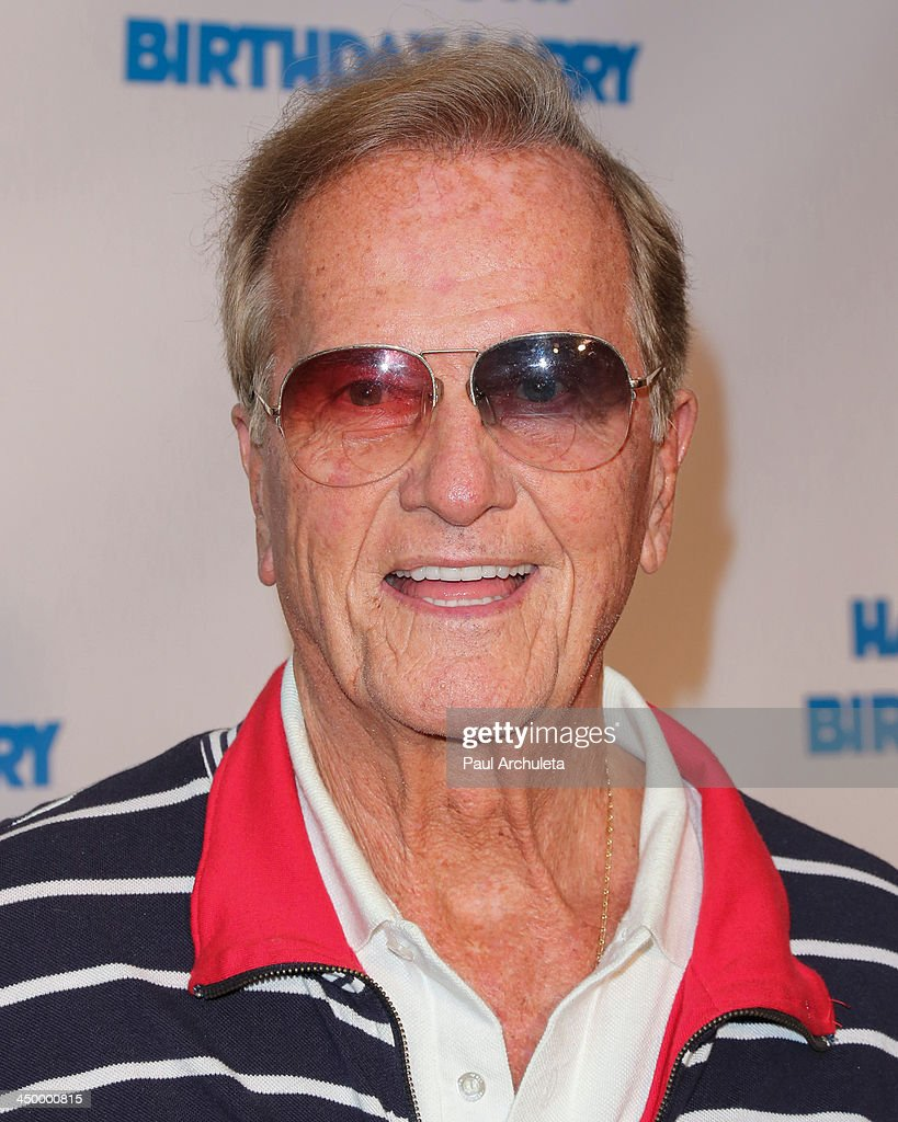 Singer Pat Boone attends a surprise party for Larry King's 80th Birthday at Dodger Stadium on November 15, 2013 in Los Angeles, California.