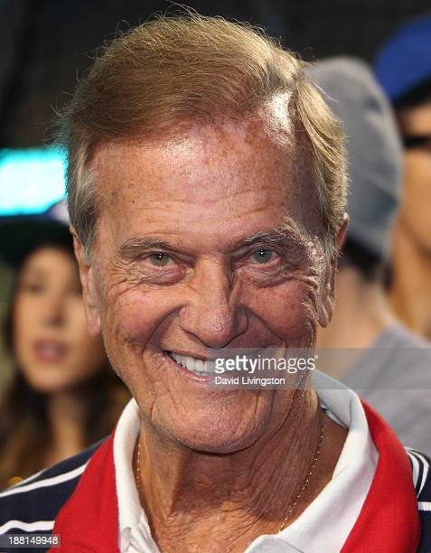 Singer Pat Boone attends Larry King's 80th birthday surprise party at Dodger Stadium on November 15 2013 in Los Angeles California