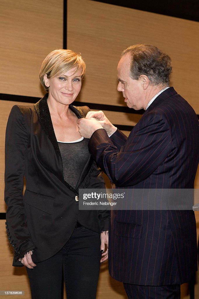 Singer <a gi-track='captionPersonalityLinkClicked' href=/galleries/search?phrase=Patricia+Kaas&family=editorial&specificpeople=586830 ng-click='$event.stopPropagation()'>Patricia Kaas</a> smiles while being honored by French Minister of Culture Frederic Mitterand during MIDEM 46th Edition at Hotel Majestic on January 28, 2012 in Cannes, France.