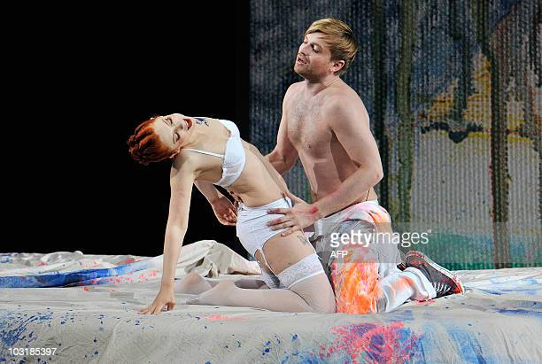 Singer Patricia Petibon and Pavol Breslik perform on stage during a dress rehearsal of Alban Berg's opera 'Lulu' in Salzburg on July 27 2010 The...