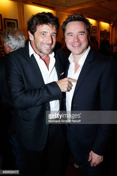 Singer Patrick Bruel and actor of the piece Guillaume de Tonquedec pose after 'Un diner d'adieu' Premiere Held at Theatre Edouard VII on September 15...
