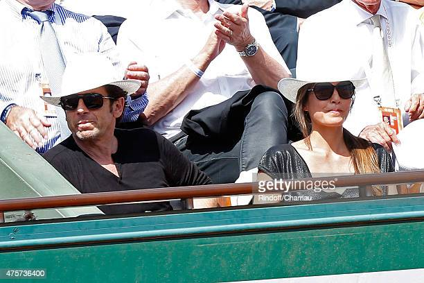 Singer Patrick Bruel and Caroline Nielsen attend the 2015 Roland Garros French Tennis Open Day Eleven on June 3 2015 in Paris France
