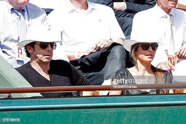 Singer Patrick Bruel and Caroline Nielsen attend the 2015 Roland Garros French Tennis Open Day Eleven on June 3 2015 in Paris France