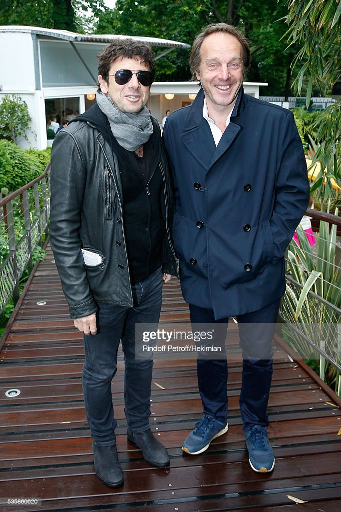 Singer <a gi-track='captionPersonalityLinkClicked' href=/galleries/search?phrase=Patrick+Bruel&family=editorial&specificpeople=549816 ng-click='$event.stopPropagation()'>Patrick Bruel</a> and Herve Taieb attend Day Nine of the 2016 French Tennis Open at Roland Garros on May 30, 2016 in Paris, France.