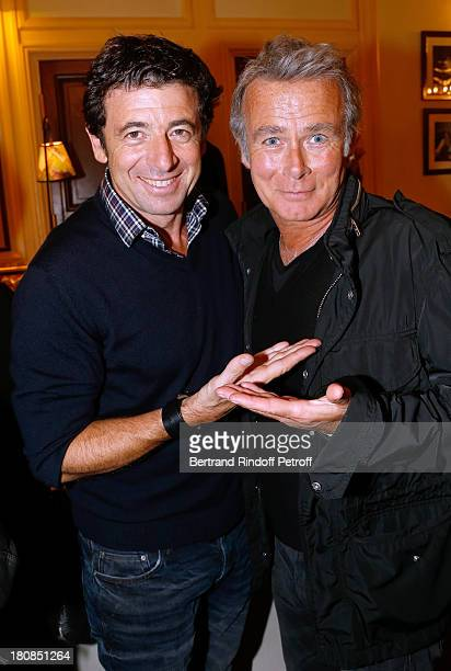 Singer Patrick Bruel and humorist Franck Dubosc after 'Nina' Premiere at Theatre Edouard VII on September 16 2013 in Paris France