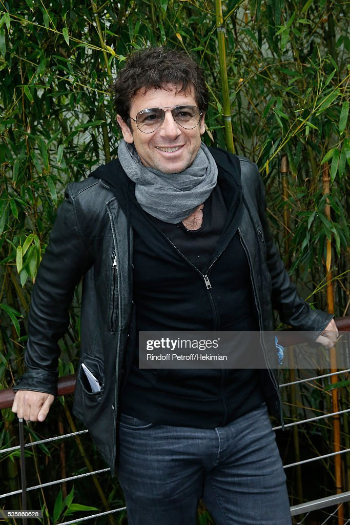 Singer <a gi-track='captionPersonalityLinkClicked' href=/galleries/search?phrase=Patrick+Bruel&family=editorial&specificpeople=549816 ng-click='$event.stopPropagation()'>Patrick Bruel</a> attends Day Nine of the 2016 French Tennis Open at Roland Garros on May 30, 2016 in Paris, France.