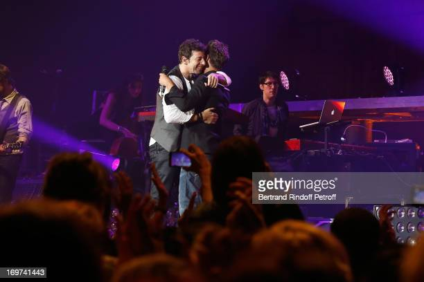 Singer Patrick Bruel perfoms with Singer Christophe Mae whyle his concert at Zenith de Paris on May 31 2013 in Paris France