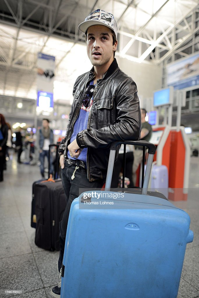 Singer Patrick Nuo waits at Frankfurt airport before the flight to Australia on January 6 2013 in Frankfurt am Main Germany TThey are participants of...