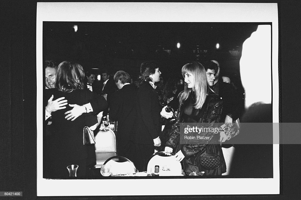 Singer Patti Scialfa, pregnant, wearing see-through, bust- revealing cocktail dress, standing w. others during the Rock & Roll Hall of Fame induction banquet at the Waldorf-Astoria Hotel.