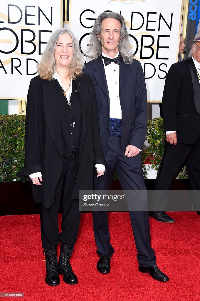 Singer Patti Smith (L) and musician Lenny Kaye attend the 72nd Annual Golden Globe Awards at The Beverly Hilton Hotel on January 11, 2015 in Beverly Hills, California.