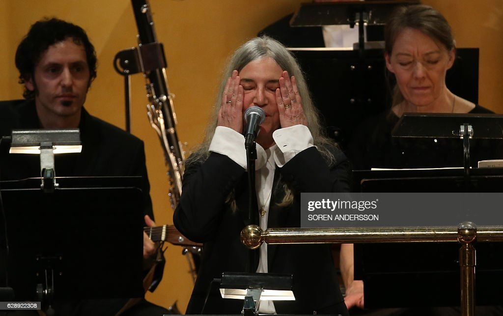 US singer Patti Smith performs during the awarding ceremony of the Nobel Prizes in medicine, economics, physics and chemistry on December 10, 2016 in Stockholm, Sweden. Nobel laureates are honoured every year on December 10 -- the anniversary of the death of prize's founder Alfred Nobel, a Swedish industrialist, inventor and philanthropist. / AFP / Soren Andersson