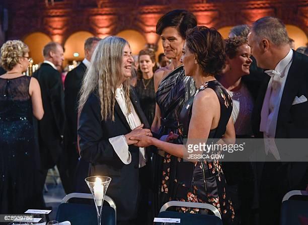 US singer Patti Smith talks to Swedish conservative leader Anna Kinberg Batra and US ambassador Azita Rajis at the 2016 Nobel prize award banquet at...