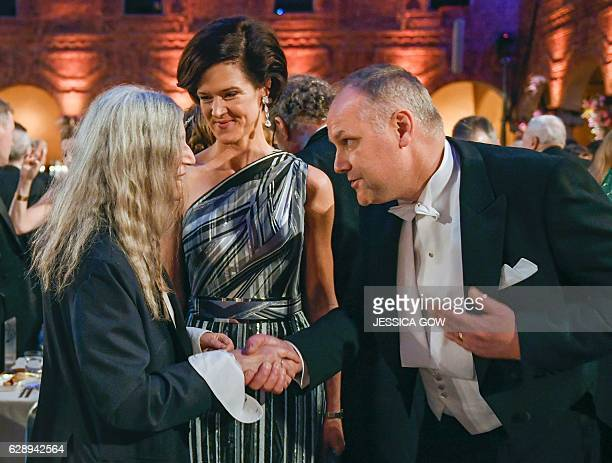 US singer Patti Smith talks to Swedish conservative leader Anna Kinberg Batra and Swedish left party leader Jonas Sjostedt at the 2016 Nobel prize...