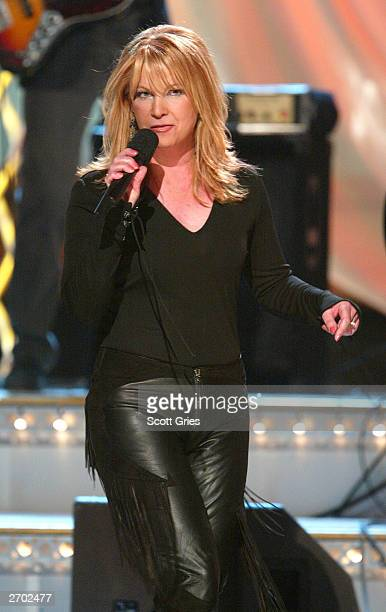 Singer Patty Loveless performs onstage at the '37th Annual CMA Awards' at the Grand Ole Opry House November 5 2003 in Nashville Tennessee
