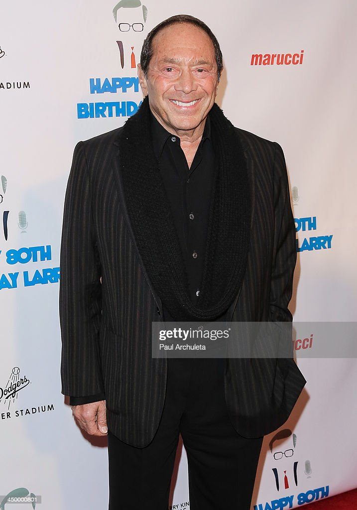Singer Paul Anka attends a surprise party for Larry King's 80th Birthday at Dodger Stadium on November 15, 2013 in Los Angeles, California.
