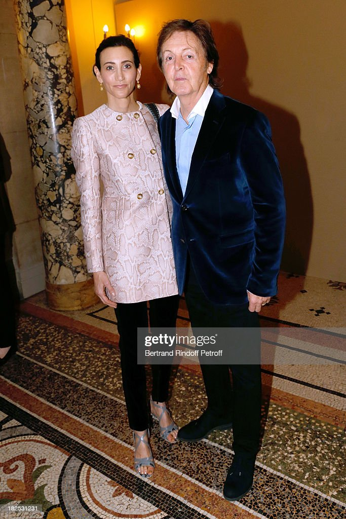 Singer Paul McCartney and his wife Nancy Shevell attend Stella McCartney show as part of the Paris Fashion Week Womenswear Spring/Summer 2014, held at Opera Garnier on September 30, 2013 in Paris, France.