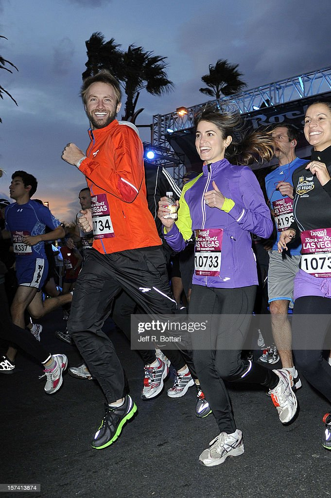 Singer Paul McDonald and actress <a gi-track='captionPersonalityLinkClicked' href=/galleries/search?phrase=Nikki+Reed&family=editorial&specificpeople=220844 ng-click='$event.stopPropagation()'>Nikki Reed</a> participate in the Zappos.com Rock 'n' Roll Las Vegas Marathon and Half-Marathon on December 2, 2012 in Las Vegas, Nevada.