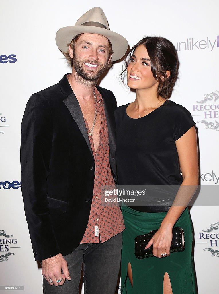 Singer Paul McDonald (L) and wife actress Nikki Reed attend the Unlikely Heroes' Recognizing Heroes Awards Dinner & Gala at The Living Room at The W Hotel on October 19, 2013 in Los Angeles, California.