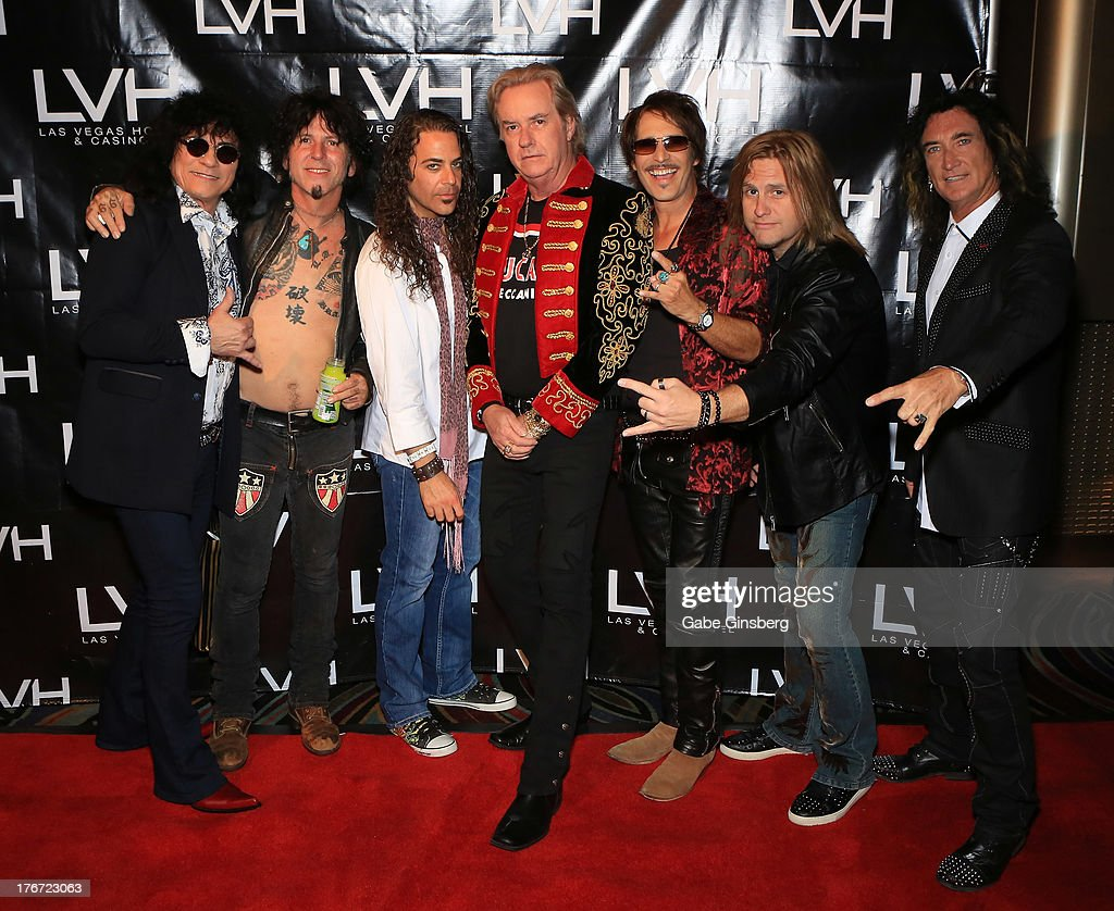 Singer Paul Shortino, guitarist Tracii Guns, keyboardist Michael T. Ross, guitarist Howard Leese, drummer Jay Schellen singer/guitarist Andrew Freeman and singer Robin McAuley arrive at the 'Night of the Champion' event to honor former boxer Leon Spinks hosted by the cast members of 'Raiding the Rock Vault' at The Las Vegas Hotel & Casino on August 17, 2013 in Las Vegas, Nevada.
