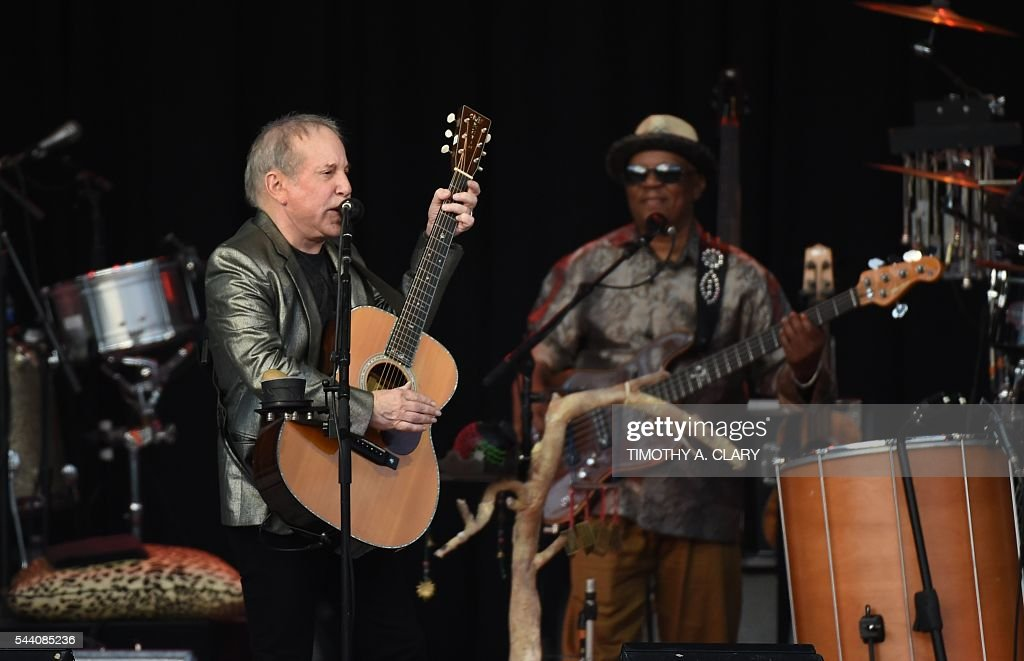 Singer Paul Simon performs at Forest Hills Stadium in the Queens borough of New York on June 30, 2016. Simon performs what could be his last major gig on US soil on July 1, 2016, in New York. Simon told The New York Times in an interview published this week that he was ready to quit. With his 75th birthday round the corner and a month-long European tour scheduled to end in Dublin on November 21, he told the newspaper that he felt his career was coming to an end. A. CLARY