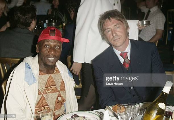 OUT} Singer Paul Weller is seen with fellow singer Jimmy Cliff at their table at the Nordoff Robbins Silver clef Awards held at the Hotel...