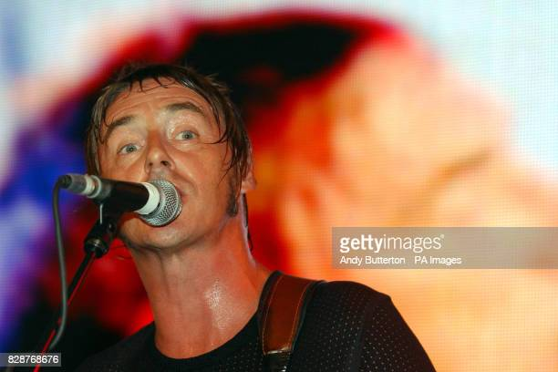 Singer Paul Weller performing on stage at HMV in Oxford Street London to celebrate the release of his new album 'Fly On The Ball'