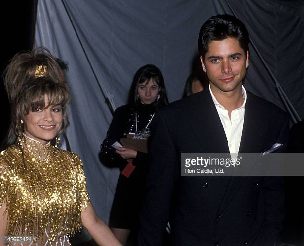 Singer Paula Abdul and actor John Stamos attend the 32nd Annual Grammy Awards on February 21 1990 at the Shrine Auditorium in Los Angeles California
