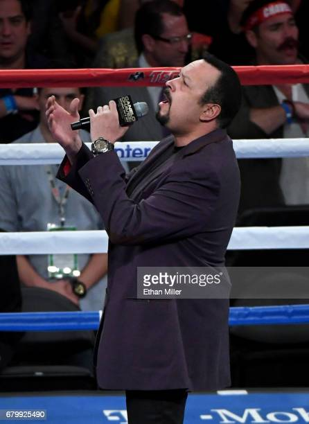 Singer Pepe Aguilar performs the Mexican national anthem before the catchweight bout between Canelo Alvarez and Julio Cesar Chavez Jr at TMobile...