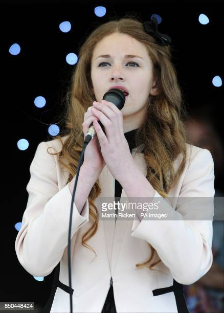 A singer performs on stage at the Everton Roadshow at Goodison Park