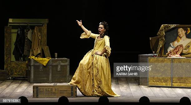 A singer performs on stage on August 30 2016 during a dress rehearsal of Gioacchino Rossini's opera 'The barber of Seville at Dubai's new opera house...