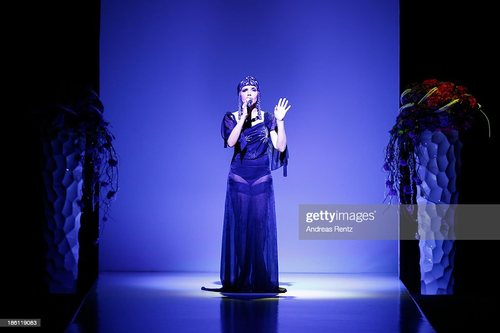 A singer performs on the runway at the ELENA SOUPROUN By Elena Suprun show during Mercedes-Benz Fashion Week Russia S/S 2014 on October 28, 2013 in Moscow, Russia.