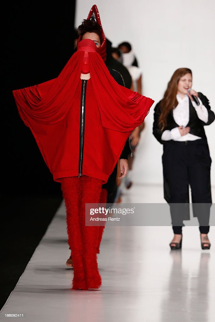 Singer performs on the runway at the finale of the Contrfashion show during Mercedes-Benz Fashion Week Russia S/S 2014 on October 28, 2013 in Moscow, Russia.