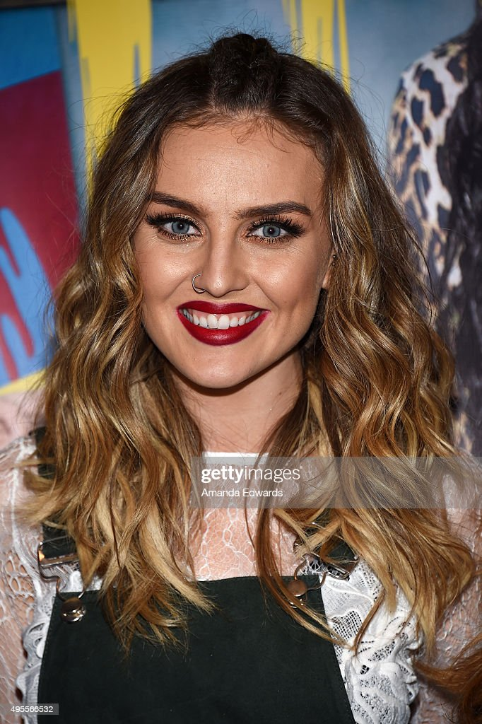 Singer Perrie Edwards of the girl band Little Mix poses before performing onstage and signing copies of their album at the Hard Rock Cafe Hollywood...