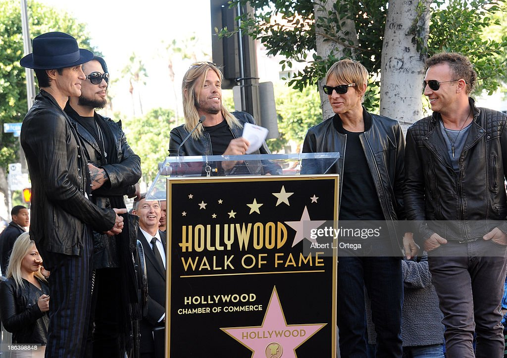 Singer Perry Farrell,guitarist Dave Navarro, drummer Taylor Hawkins of Foo Fighters, bassist Chris Chaney and drummer Stephen Perkins at Jane's Addiction Star On The Hollywood Walk Of Fame Ceremoney on October 30, 2013 in Hollywood, California.