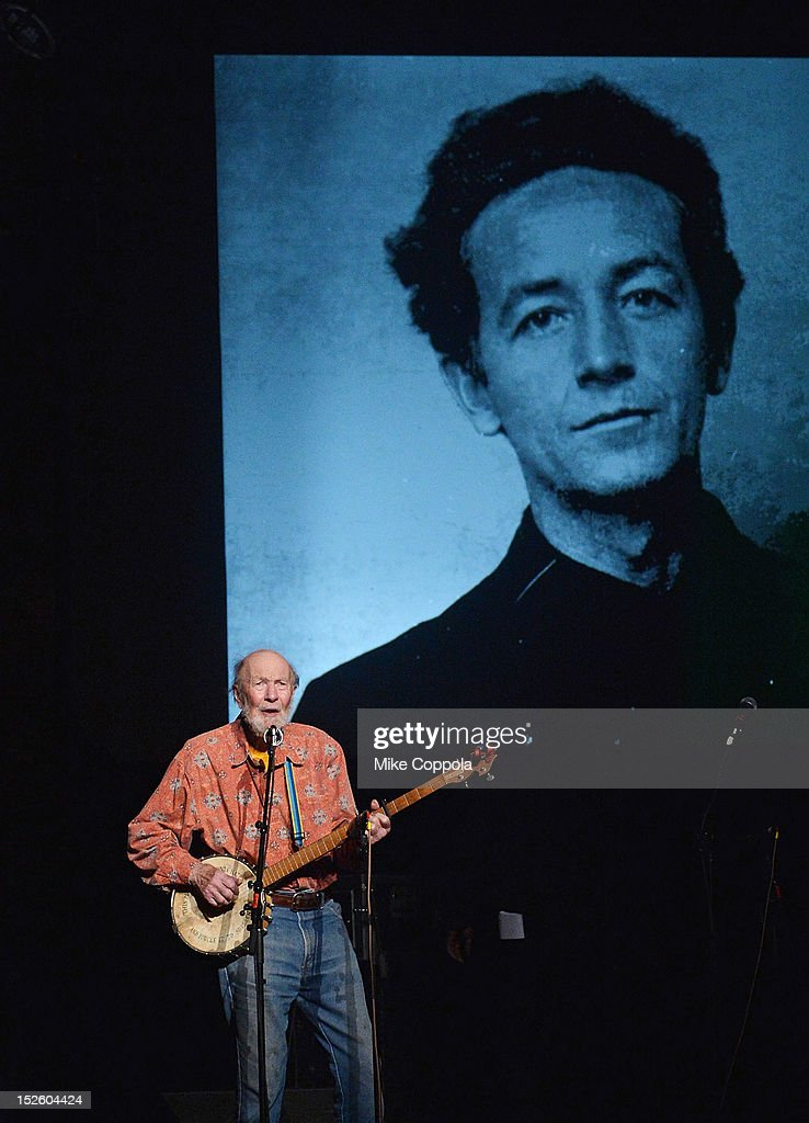 Singer Pete Seeger performs during the 'This Land Is Your Land' Woody Guthrie At 100 Concert as part of the Woody Guthrie Centennial Celebration at The Whitman Theater at Brooklyn College on September 22, 2012 in New York City.