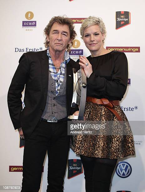 Singer Peter Maffay and TV host Ina Mueller pose with the Echo Award during the Echo 2011 Award press conference at Messe Berlin on February 3 2011...