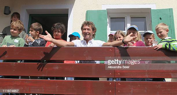 Singer Peter Maffay poses with children in front of the new 'Tabaluga house Jaegersbrunn' by his Tabaluga children foundation during the opening...