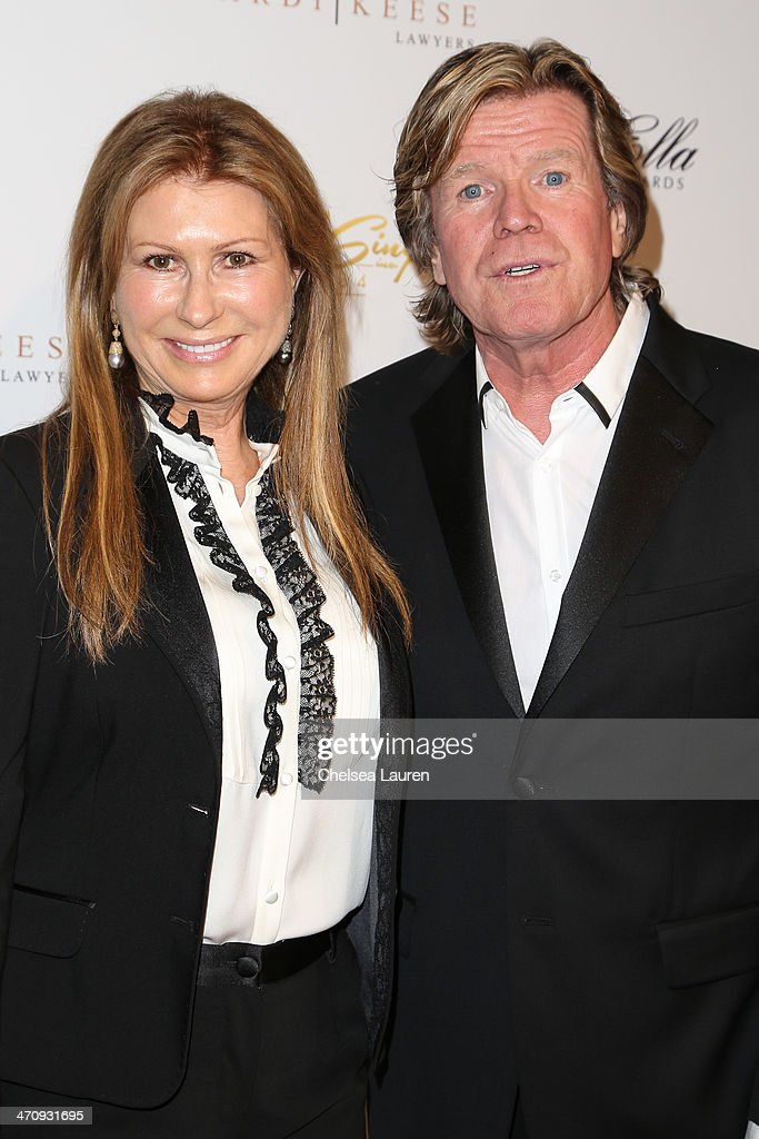 Singer peter noone r and wife mireille strasser noone arrive at the