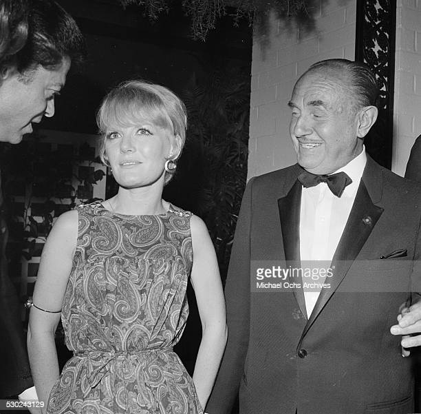 Singer Petula Clark Movie Executive Jack Warner attend an event in Los AngelesCA