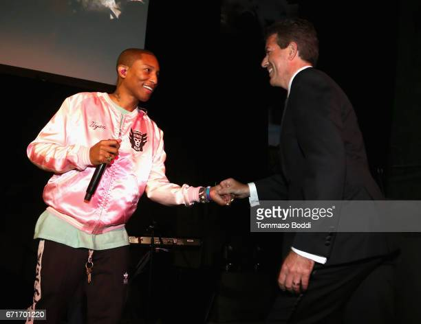 Singer Pharrell Williams and CEO and President Humane Society of the United States Wayne Pacelle at The Humane Society of the United States' To the...